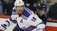 New York Rangers forward Brad Richards (19) takes out Winnipeg Jets forward Andrew Ladd (16) during first period NHL action in Winnipeg on Monday, October 24, 2011. (JOHN WOODS/THE CANADIAN PRESS)