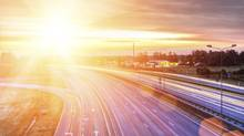 Picture of a highway at sunset (Andrejs Pidjass/Getty Images/iStockphoto)