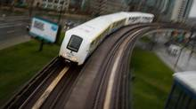 A SkyTrain commuter train travels into downtown Vancouver. (DARRYL DYCK FOR THE GLOBE AND MAIL)