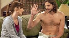 "Judy Greer and Ashton Kutcher in a scene from an episode of the CBS comedy ""Two and a Half Men"" (ADAM ROSE/CBS)"