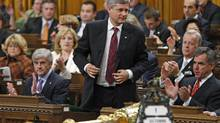 Prime Minister Stephen Harper stands to vote against the Liberal no-confidence motion in the House of Commons on Oct. 1, 2009. (CHRIS WATTIE/Reuters)