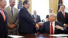 United Steelworkers president Leo Gerard shakes hands with U.S. President Donald Trump. (AARON P. BERNSTEIN/REUTERS)