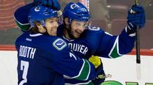 Vancouver Canucks forward David Booth, left, and Brad Richardson celebrate Richardson's winning goal against the Los Angeles Kings during third period NHL action in Vancouver on April 5, 2014. (Darryl Dyck/The Canadian Press)