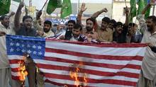 Supporters of Pakistan Muslim League-Nawaz (PML-N) burn a US flag during a protest in Multan on November 28, 2011, against a NATO strike on Pakistan troops. (S.S. MIRZA/S.S. MIRZA/AFP/Getty Images)