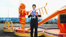 Team Canada figure skater Patrick Chan visits the McDonald's Cheers to Sochi Kiosk in the Athlete Village to read good luck messages sent from fans during the 2014 Sochi Winter Olympics on February 19, 2014 in Sochi, Russia. (Marianna Massey/Getty Images)