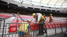 Constructions workers install seats in the newly redesigned BC Place stadium in Vancouver on Sept. 29, 2011. (Jeff Vinnick for The Globe and Mail)