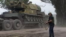 Ukrainian government forces maneuver antiaircraft missile launchers as they are transported north-west from Slovyansk, eastern Ukraine Friday, July 4, 2014. (Dmitry Lovetsky/AP)