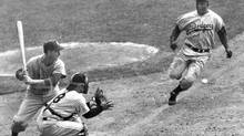 JJackie Robinson, right, of the Brooklyn Dodgers races down the third base line on his way to a daring steal of home plate in the opening game of the 1955 World Series at Yankee Stadium, in this Sept. 28, 1955 file photo. (MEYER LEBOWITZ/NYT)
