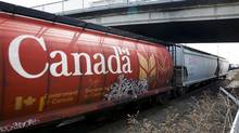 A Canadian Pacific Rail train hauling grain passes through Calgary, Thursday, May 1, 2014. T (Jeff McIntosh/THE CANADIAN PRESS)