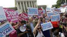 Supporters of President Barack Obama's health care law celebrate outside the Supreme Court in Washington, Thursday, June 28, 2012, after the court's ruling. (David Goldman/AP)