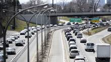 With one westbound lane (right) closed until late 2016, traffic leaving downtown Toronto is bumper to bumper in this April file photo. Delays are expected around Toronto this weekend. (Fred Lum/The Globe and Mail)