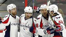 Washington Capitals' Mike Richards (10) celebrates his goal against the Ottawa Senators with teammates Karl Alzner (7), Daniel Winnik (26) and Tom Wilson (43) during first period NHL hockey action in Ottawa on Tuesday, March 22, 2016. (FRED CHARTRAND/THE CANADIAN PRESS)