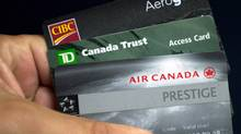 Your best bet is to bring a credit card that doesn't charge currency exchange fees (Ryan Remiorz/THE CANADIAN PRESS)