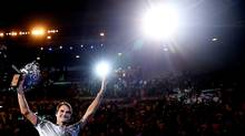 Roger Federer waves to fans in the crowd as he does a lap of honour after winning the men's final match against Rafael Nadal at the Australian Open on Jan. 29, 2017. (Scott Barbour/Getty Images)