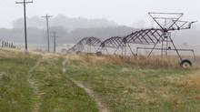 An irrigation pivot remains still along highway 14, several miles near the proposed new route for the Keystone XL pipeline, Thursday, April 19, 2012 in Neligh, Neb. (Nati Harnik/AP)