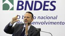 Luciano Coutinho, president of the Brazilian National Development Bank (BNDES), gestures as he answers a question during a news conference in Rio de Janeiro April 19, 2012. Coutinho talked about the performance of BNDES in the first quarter of 2012. (SERGIO MORAES/REUTERS)