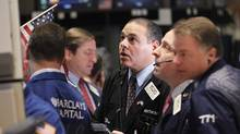 Traders work on the floor of the New York Stock Exchange, January 17, 2012. (BRENDAN MCDERMID/Brendan McDermid/Reuters)