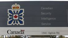 A vehicle passes a sign outside the Canadian Security Intelligence Service (CSIS) headquarters in Ottawa November 5, 2014. (CHRIS WATTIE/REUTERS)