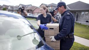 RCMP investigators remove evidence from a home in London, Ontario August 26, 2010 where they arrested a man in a Terrorism related investigation. GEOFF ROBINS The Globe and Mail