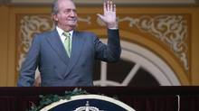 Spain's King Juan Carlos waves shortly before a bullfight at Las Ventas bullring in Madrid on June 4, 2014. The King said on Monday he would abdicate in favour of his son Prince Felipe, aiming to revive the scandal-hit monarchy at a time of economic hardship and growing discontent with the wider political elite. (JUAN MEDINA/REUTERS)