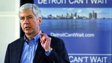 Michigan Governor Rick Snyder talks to a group of people about the city of Detroit being in a financial emergency state during a Town Hall style meeting in Detroit, Michigan March 1, 2013. (REBECCA COOK/REUTERS)