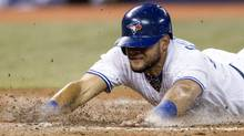 Toronto Blue Jays Melky Cabrera scores at home plate after a single from Maicer Izturis against Houston Astros during fifth inning AL baseball action in Toronto on Wednesday April 9, 2014. (Chris Young/THE CANADIAN PRESS)