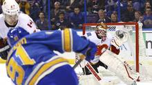 Calgary goalie Brian Elliott has been a key part of the team's recent surge, which has made the playoff race a fight to the finish. (Billy Hurst/USA Today Sports)