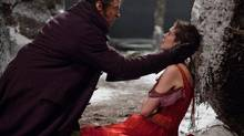 "This film image released by Universal Pictures shows Hugh Jackman as Jean Valjean, left, and Anne Hathaway as Fantine in a scene from ""Les Miserables."" (Handout/AP)"