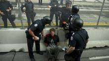 Police arrest a protester aolng the fence during the G8/G20 June 26, 2010 in Toronto. (Don Emmert/AFP/Getty Images/Don Emmert/AFP/Getty Images)