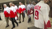 Paul Henderson, in glasses, arrives with his old team members to Nathan Philips Square in Toronto during an event to recognize the hockey players of Team Canada 1972 before their Canada's Walk of Fame induction Sept. 21, 2012 (Peter Power/The Globe and Mail)