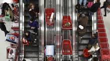 Shoppers ride an escalator at a Target Store in Chicago, November 25, 201. (JOHN GRESS/JOHN GRESS/REUTERS)
