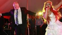 Mayor Rob Ford dances with performer Jenny James in Scarborough on Friday. (Peter Power/The Globe and Mail)