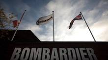 Flags of the United Kingdom, Bombardier Inc. and Canada fly outside Britain's sole remaining railcar factory, operated by Bombardier Inc. and known as Litchurch Lane, in Derby, U.K., on Wednesday, Dec. 21, 2011. (Jason Alden/Bloomberg)