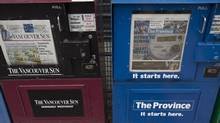 Newspaper boxes containing the Vancouver Sun and the Province are seen in downtown Vancouver. (JONATHAN HAYWARD/THE CANADIAN PRESS)