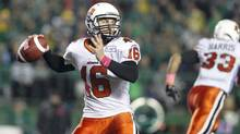 BC Lions quarterback Thomas DeMarco looks to make the pass while playing against the Saskatchewan Roughriders during the second half of their CFL game in Regina, Saskatchewan October 19, 2013. (DAVID STOBBE/REUTERS)