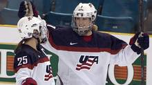The U.S. women's hockey team is threatening to boycott the world championships because of a wage dispute. (Jeff Bassett/AP)