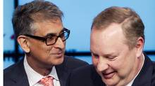 Rogers Communications CEO Nadir Mohamed, left, and his BCE counterpart George Cope. (MARK BLINCH/REUTERS/MARK BLINCH/REUTERS)