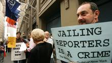Jeff Z. Klein, an editor at The New York Times, gathers with fellow employees outside the newspaper's editorial offices on July 6, 2005. Time magazine reporter Matthew Cooper and New York Times reporter Judith Miller had refused to provide the identity of their confidential source who had revealed a CIA officer's identity. Federal prosecutor Special Counsel Patrick Fitzgerald said Mr. Cooper and Ms. Miller should be jailed for refusing to reveal their confidential sources to a grand jury investigating the leak of a covert CIA operative's name to the news media. (MIKE SEGAR/REUTERS)