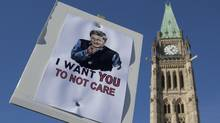 The Peace Tower is seen behind a sign mocking Prime Minister Stephen Harper during an Ottawa anti-prorogation rally on Saturday, Jan. 23, 2010.
