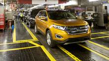 A Ford Edge sits ready for the ceremonial drive off the line during Ford's official kick-off of the new 2015 Ford Edge production at the assembly plant in Oakville, Ontario on Thursday, February 26, 2015. Ford Motor Co. of Canada Ltd. chief executive officer Dianne Craig says key automotive provisions of the Trans-Pacific Partnership trade agreement are bad for Canada, so the new Liberal government needs to take a careful look at the deal before approving it. (Peter Power For The Globe and Mail)