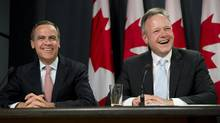 Bank of Canada Governor Mark Carney with his successor, Stephen Poloz, May 2, 2013. (Adrian Wyld/THE CANADIAN PRESS)