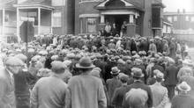 April, 1934, in the midst of the Great Depression. A Street meeting of unemployed in Toronto. A government cheque for one cent was exhibited to the crowd. It was in payment for work in a Northern Ontario camp. The crowd had gathered in front of the York Township Relief Office on Sellers Ave. to present demands to the Relief Officer. (John Boyd/The Globe and Mail)