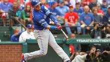 Troy Tulowitzki #2 of the Toronto Blue Jays hits a home run against the Texas Rangers during the second inning in game two of the American League Divison Series. (Scott Halleran/Getty Images)