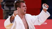Canada's Antoine Valois-Fortier celebrates after defeating Travis Stevens of the U.S. during their men's -81kg bronze medal B judo match at the London 2012 Olympic Games July 31, 2012. (Reuters)