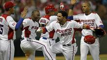 Mike Aviles, second from right, celebrates with teammates after hitting a two run home run against the Dominican Republic last Sunday. (Andres Leighton/AP)