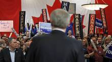 Supporters cheer for Conservative Leader Stephen Harper during a campaign rally in Winnipeg on March 29, 2011. (CHRIS WATTIE/REUTERS)