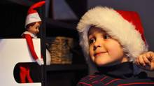 George the Elf with Zacharie Bishop in Calgary, Alberta. (Todd Korol/Todd Korol/The Globe and Mail)
