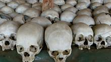 A Christian figure stand between human skulls, Wednesday, Aug 20, 2003 at the Ntarama church in Nyamata south of Kigali where up to 5,000 people were killed during the 1994 Rwanda genocide . (AP/KAREL PRINSLOO/AP/KAREL PRINSLOO)