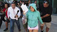 Lilia Ratmanski, 25, is released on bail at the Brampton courthouse on Thursday August 28, 2014. A booze-fuelled fight between two women who were allegedly drinking and smoking in an airplane bathroom prompted Sunwing to turn a Cuba-bound flight back to Toronto, the airline said. (Aaron Vincent Elkaim/THE CANADIAN PRESS)