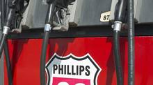 In this July 22, 2011 photo, pumps at a Phillips 66 gas station display the company logo in Omaha, Neb. (Nati Harnik/The Associated Press)